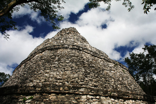 The Xaibe Pyramid stands at a mayor junction of limestone Maya roads